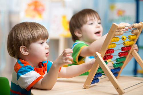 Boys using an abacus, Shutterstock.