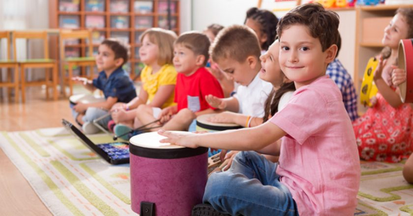 Preschool kids play instruments