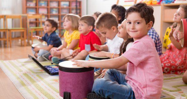 Preschool kids play instruments